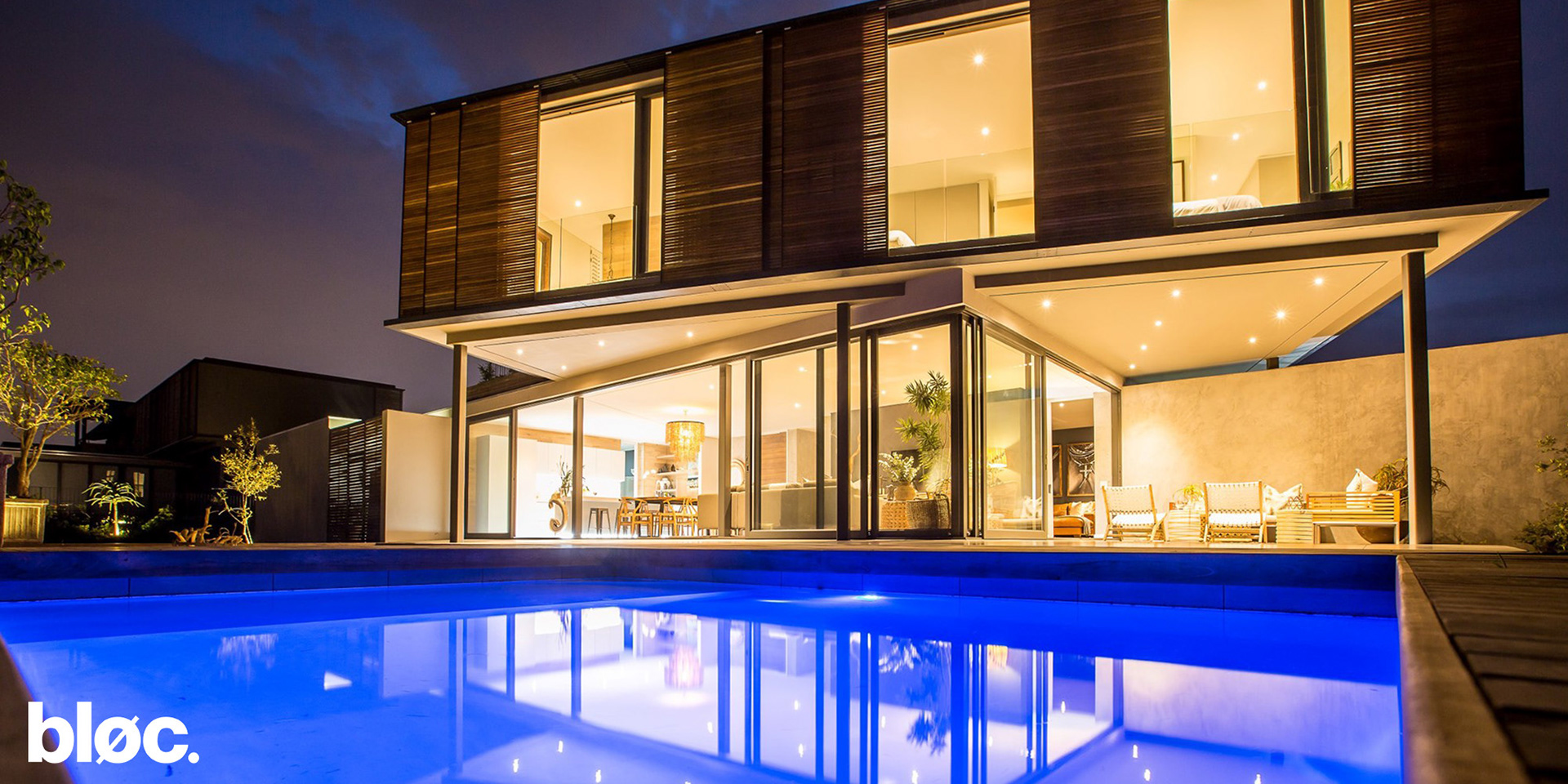 Modern double storey home with sliding timber screens